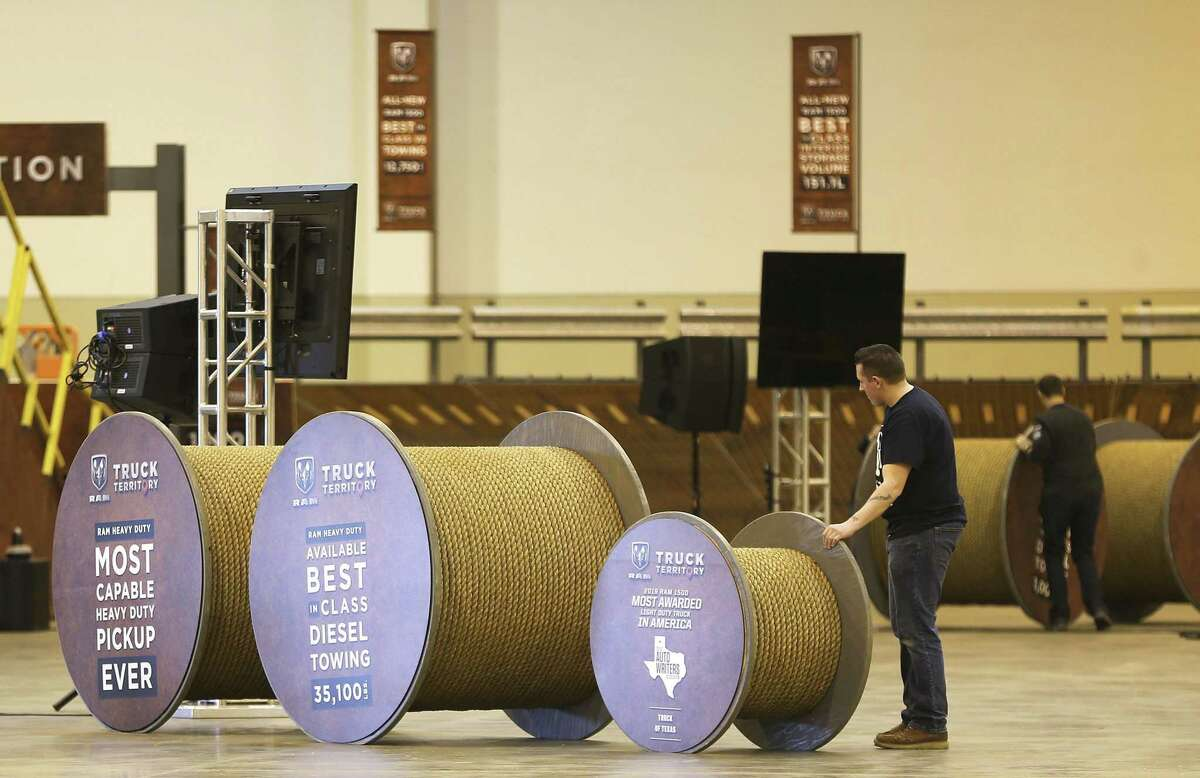 Workers display spools the Jeep Display for the Houston Auto Show at NRG Center on Tuesday, January 22, 2019.