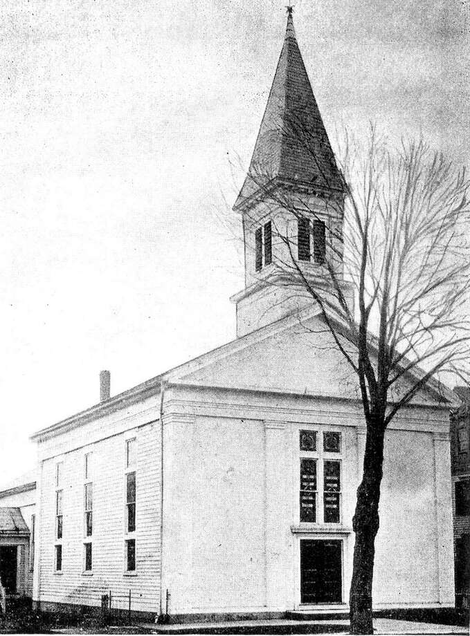 "The Methodist Church in New Milford stands along Elm Street in the postcard photograph by P.M. Cassedy from the early 20th century. The church called Elm Street home until the 1960s when it moved as the United Methodist Church to its present location on Route 7. Next door to the Methodist Church during New Milford's early 20th century days was the town's Roman Catholic church, St. Francis Xavier, a parish that moved to its present home along Chestnutland Road. If you have a ""Way Back When"" photograph you'd like to share, contact Deborah Rose at drose@newstimes.com or 860-355-7324. Photo: Courtesy Of Gina Kensek / The News-Times Contributed"