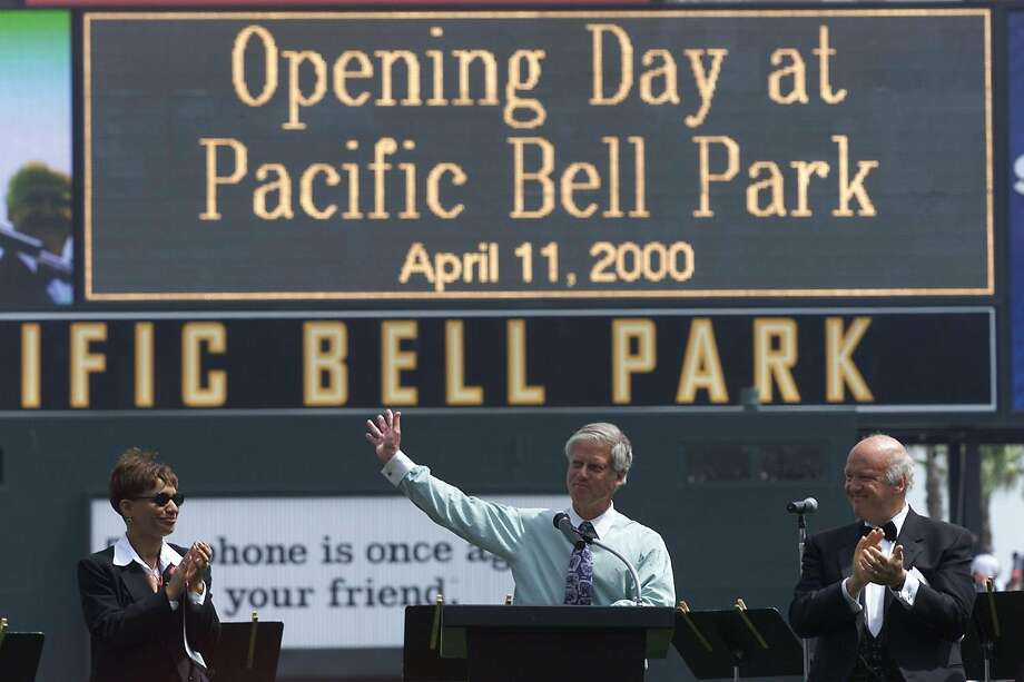 Giants principal owner Peter Magowan speaks to the sell-out crowd during opening ceremonies at Pac-Bell Park on April 10, 2000 with Giants PA announcer Renel Brooks-Moon, left, and broadcaster Jon Miller. Photo: LANCE IVERSEN / SFC