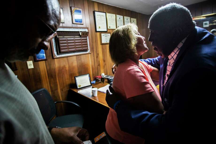 Ross Mortuary CEO Edward Loche, right, embraces Carolyn Hoxie after finishing the funeral arrangements of Hoxie's mother. Photo: Marie D. De Jesús, Staff Photographer / © 2018 Houston Chronicle