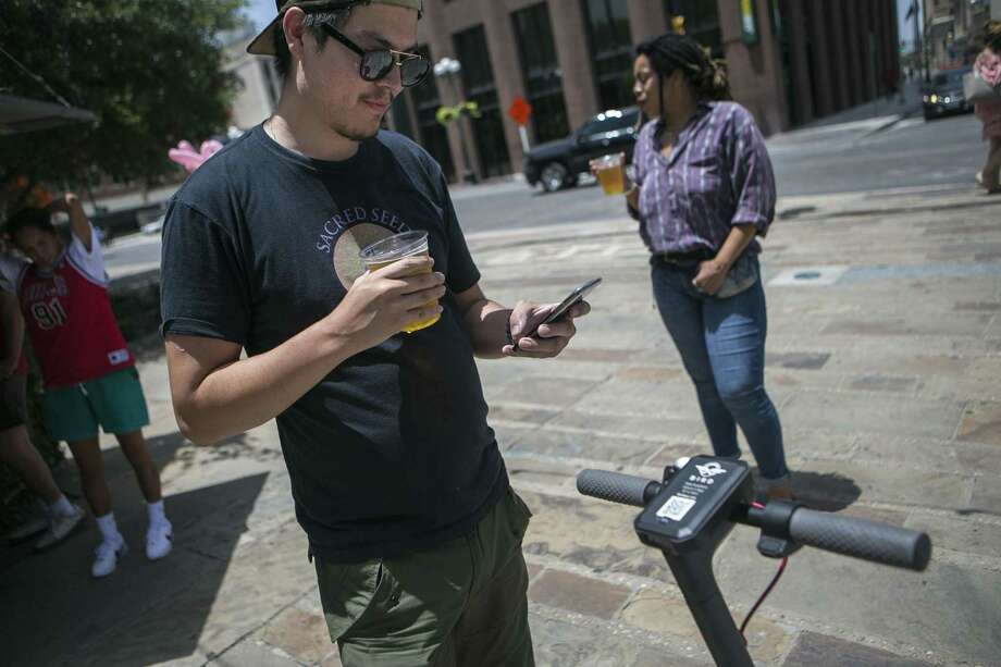 One sign of the growing presence of millennials in San Antonio is the proliferation of electric scooters. Inexpensive to rent and fun to ride, scooters have quickly become a popular substitute for cars.  Photo: Josie Norris, Express-News / © San Antonio Express-News