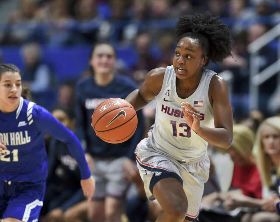 UConn's Christyn Williams (13) drives down the court against Seton Hall on Dec. 8 in Hartford. Photo: Stephen Dunn / Associated Press / Copyright 2018 The Associated Press. All rights reserved