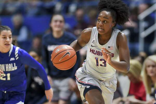 UConn's Christyn Williams (13) drives down the court against Seton Hall on Dec. 8 in Hartford.