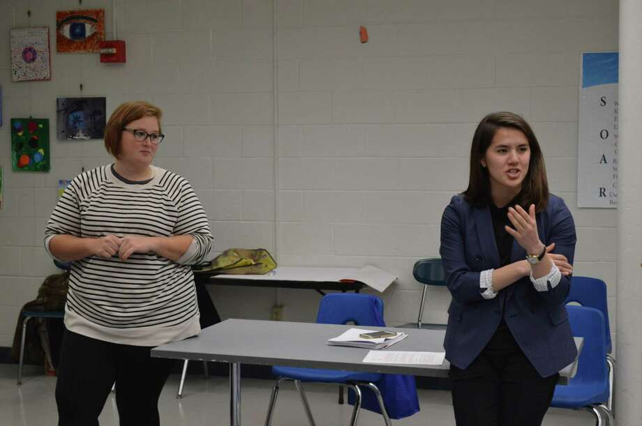 Elizabeth Nearing and Caroline Smith from the Could Be Fund talk during the Newhallville Community Management Team Meeting at Lincoln Bassett School Jan. 22, 2019. Photo: Clare Dignan / Hearst Connecticut Media