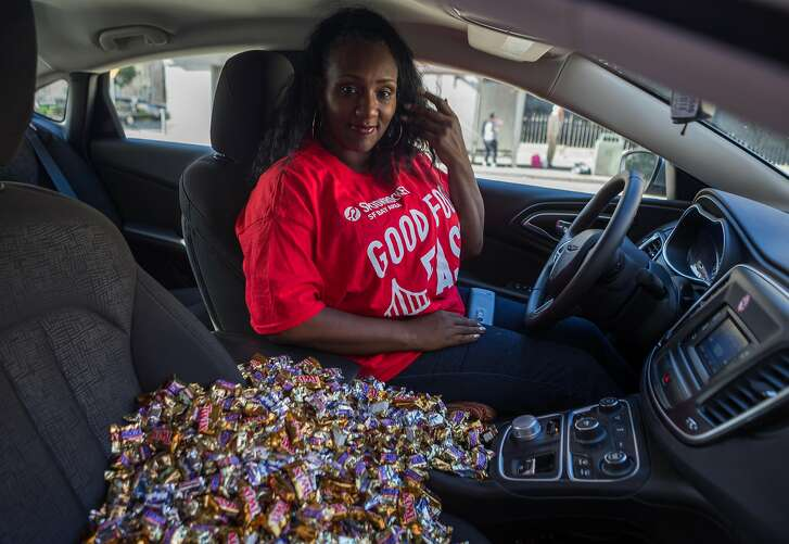 Danetta Davies of SpoonRocket delivers an order of candy to The San Francisco Chronicle's office on Monday, Oct. 26, 2015 in San Francisco, Calif.  SpoonRocket which normally delivers ready-made meals in under 15 minutes is offering a special halloween candy service this week only.