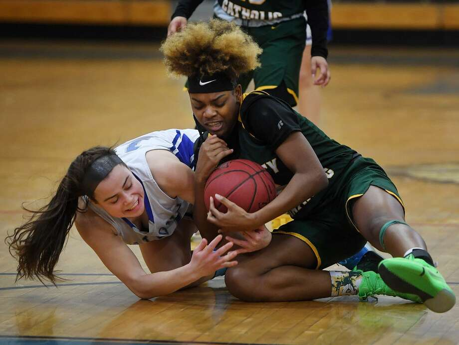 Fairfield Ludlowe's Bridget Paulmann, left, scrambles for a loose ball with Trinity Catholic's Kyah Nowlin Tuesday's game at Ludlowe High in Fairfield. Photo: Brian A. Pounds / Hearst Connecticut Media / Connecticut Post