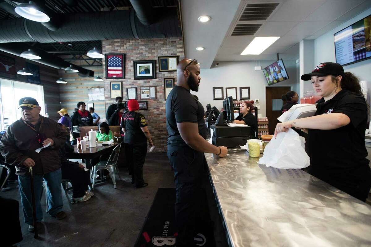 Gary Priest, a TSA worker picks up food at Ray's BBQ Shack on Monday, Jan. 21, 2019, in Houston. The bbq restaurant announced that from 1 p.m. to 4 p.m., furloughed federal workers are welcomed to pick up a meal for free on Martin Luther King Jr. Day.