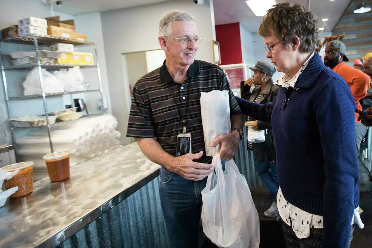 Gary Priest, a furloughed NASA engineer and his wife Susan Priest pick up food at Ray's BBQ Shack on Monday, Jan. 21, 2019, in Houston. The bbq restaurant announced that from 1 p.m. to 4 p.m., furloughed federal workers are welcomed to pick up a meal for free on Martin Luther King Jr. Day.