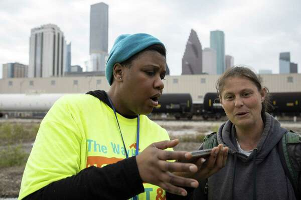 Tiffany Brown, left, conducts a questionnaire with Jimmie Jones during the Annual Houston Homeless Count Tuesday, Jan. 22, 2019, in Houston.