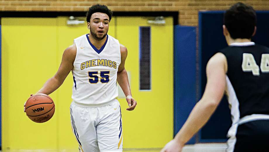 Midland High's Isaiah Bridges brings the ball upcourt during a game against Bay City Western last week. Bridges had game highs of 22 points and 14 rebounds in the Chemics' 52-40 loss to Saginaw High on Tuesday. Photo: Daily News File Photo