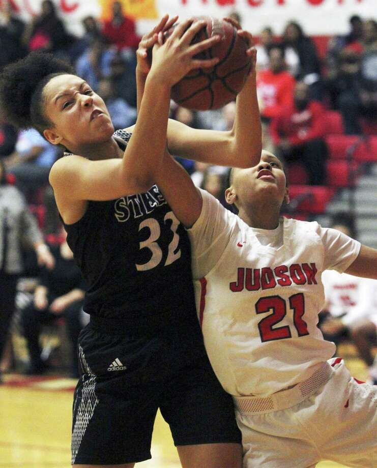 Steele's Sydney Cajero grabs a rebound over Tiffany McGarity as Judson hosts Steele in girls basketball at Judson High School gym on January 22, 2019. Photo: Melanie Reel, Staff / Staff Photographer / 2019 SAN ANTONIO EXPRESS-NEWS