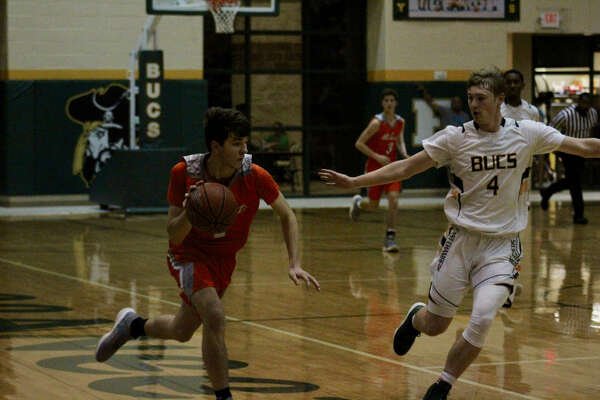 East Chambers dribbles the ball up the court in the game against Orangefield on Tuesday Night in Winnie.