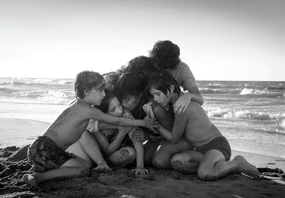 "This image released by Netflix shows Yalitza Aparicio, center, in a scene from the film ""Roma,"" by filmmaker Alfonso Cuaron. On Tuesday, Jan. 22, 2019, the film was nominated for an Oscar for both best foreign language film and best picture. The 91st Academy Awards will be held on Feb. 24. (Carlos Somonte/Netflix via AP) Photo: Carlos Somonte / Netflix"