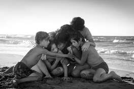"This image released by Netflix shows Yalitza Aparicio, center, in a scene from the film ""Roma,"" by filmmaker Alfonso Cuaron. On Tuesday, Jan. 22, 2019, the film was nominated for an Oscar for both best foreign language film and best picture. The 91st Academy Awards will be held on Feb. 24. (Carlos Somonte/Netflix via AP)"