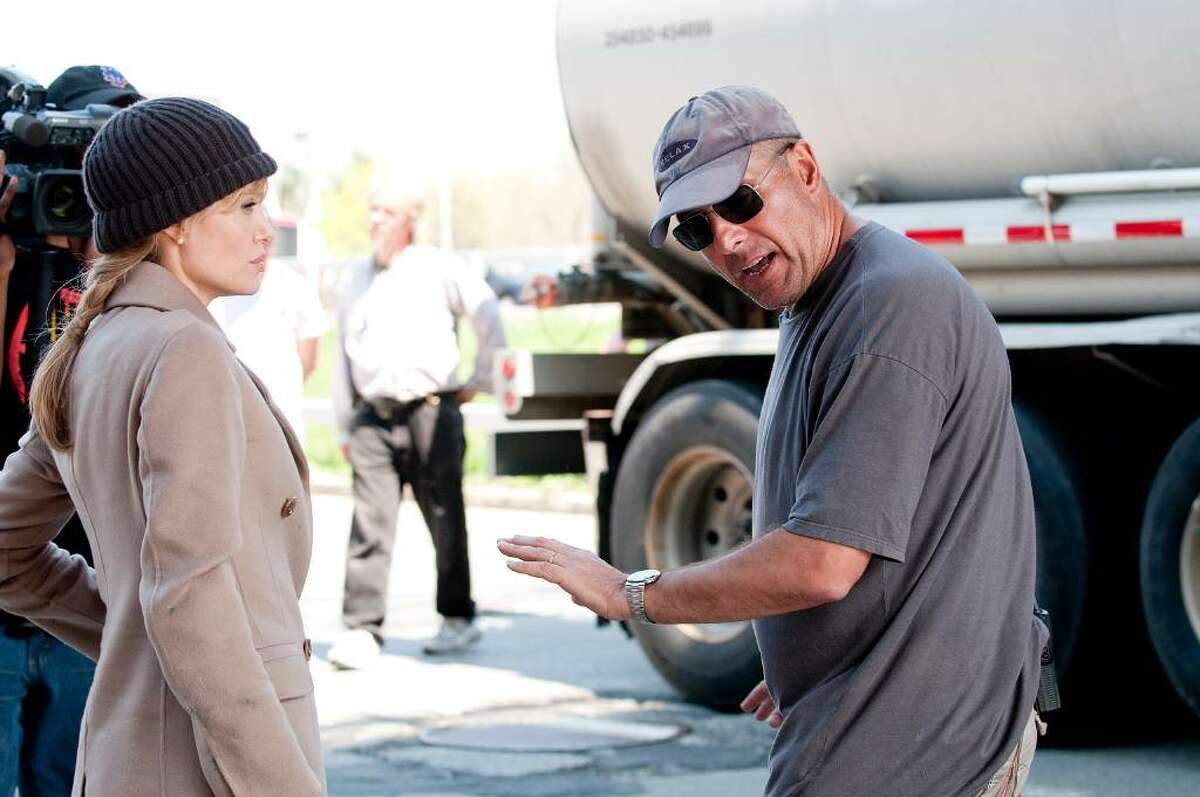 Angelina Jolie with stunt coordinator Simon Crane on the set of Columbia Pictures'