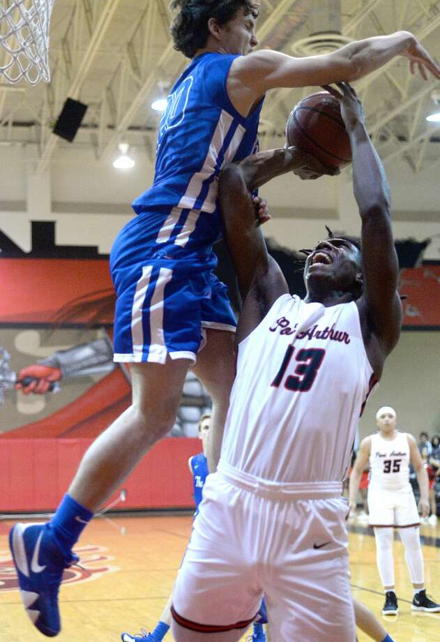 Port Arthur Memorial's Nate Clover tries to put up his shot against Barbers Hill's Caleb Durham during their district match-up Tuesday at Memorial. Photo taken Tuesday, January 22, 2019 Photo by Kim Brent/The Enterprise Photo: Kim Brent/The Enterprise