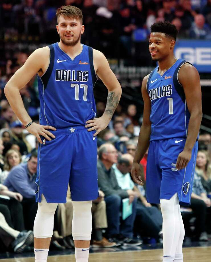 Dallas Mavericks Luka Doncic (77) of Germany and teammate Dennis Smith Jr. (1) share a laugh during the first half of an NBA basketball game against the LA Clippers in Dallas, Tuesday, Jan. 22, 2019. (AP Photo/LM Otero) Photo: LM Otero / Copyright 2019 The Associated Press. All rights reserved.