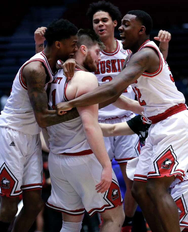 Northern Illinois forward Noah McCarty (11), second from left, celebrates with teammates after scoring the game-winning basket against Buffalo during the second half of an NCAA college basketball game Tuesday, Jan. 22, 2019, in DeKalb, Ill. Northern Illinois won 77-75. (AP Photo/Nam Y. Huh) Photo: Nam Y. Huh / Copyright 2019 The Associated Press. All rights reserved.