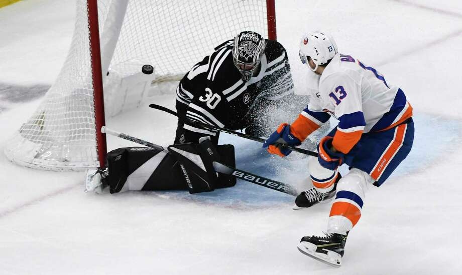 New York Islanders center Mathew Barzal (13) scores a gaol past Chicago Blackhawks goaltender Cam Ward (30) during the second period of an NHL hockey game on Tuesday Jan. 22, 2019, in Chicago. (AP Photo/Matt Marton) Photo: Matt Marton / Copyright 2019 The Associated Press. All Rights Reserved.r