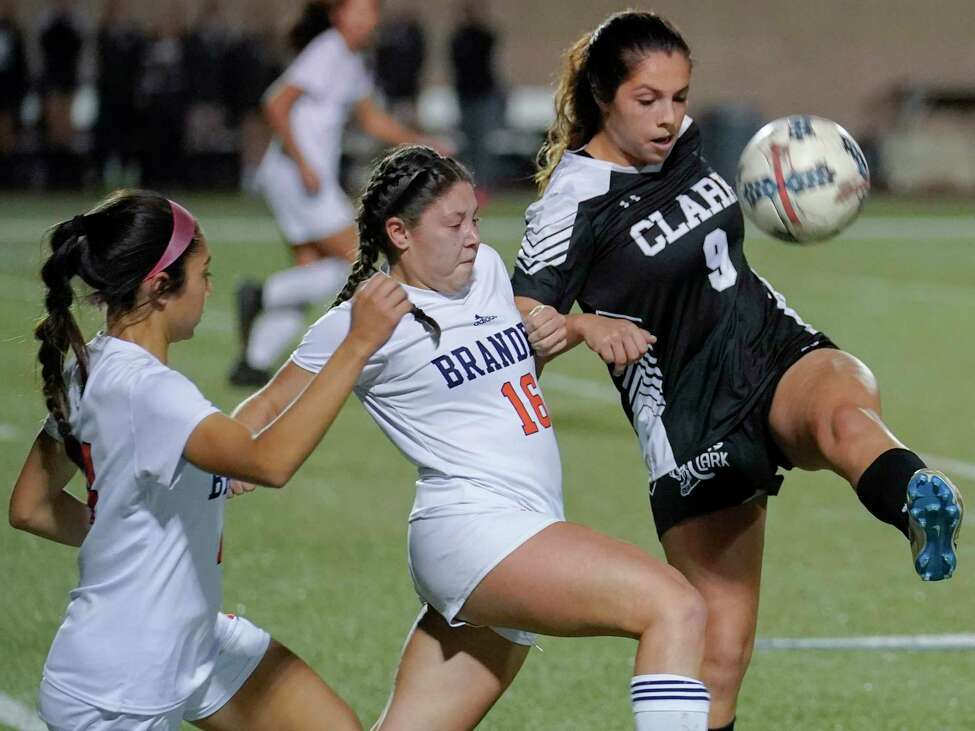 Clark's Andrea Santos (9) battles Brandeis' Megan Gomez-Leon (16) for control of the ball during the second half of a girls high school soccer game, Tuesday, Jan. 22, in San Antonio. Clark won 2-1. (Darren Abate/Contributor)
