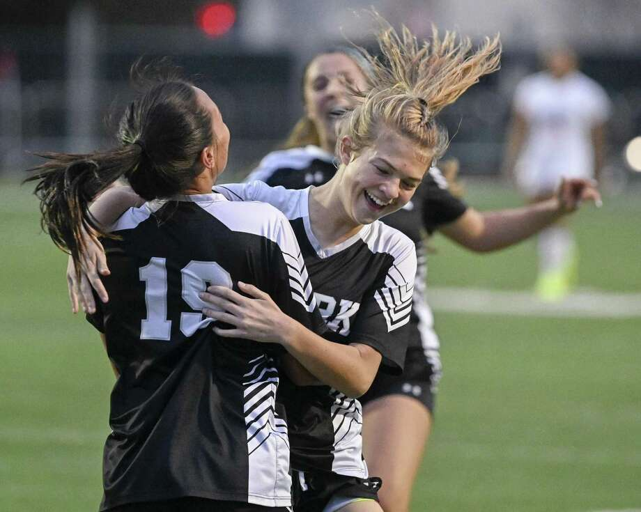 Clark's Hannah Faustino, left, celebrates a goal with teammate Emma Nylund during the second half of a girls high school soccer game against Brandeis, Tuesday, Jan. 22, in San Antonio. Clark won 2-1. (Darren Abate/Contributor) Photo: Darren Abate, FRE / San Antonio Express-News