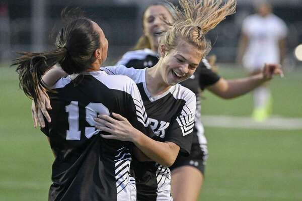 Clark's Hannah Faustino, left, celebrates a goal with teammate Emma Nylund during the second half of a girls high school soccer game against Brandeis, Tuesday, Jan. 22, in San Antonio. Clark won 2-1. (Darren Abate/Contributor)