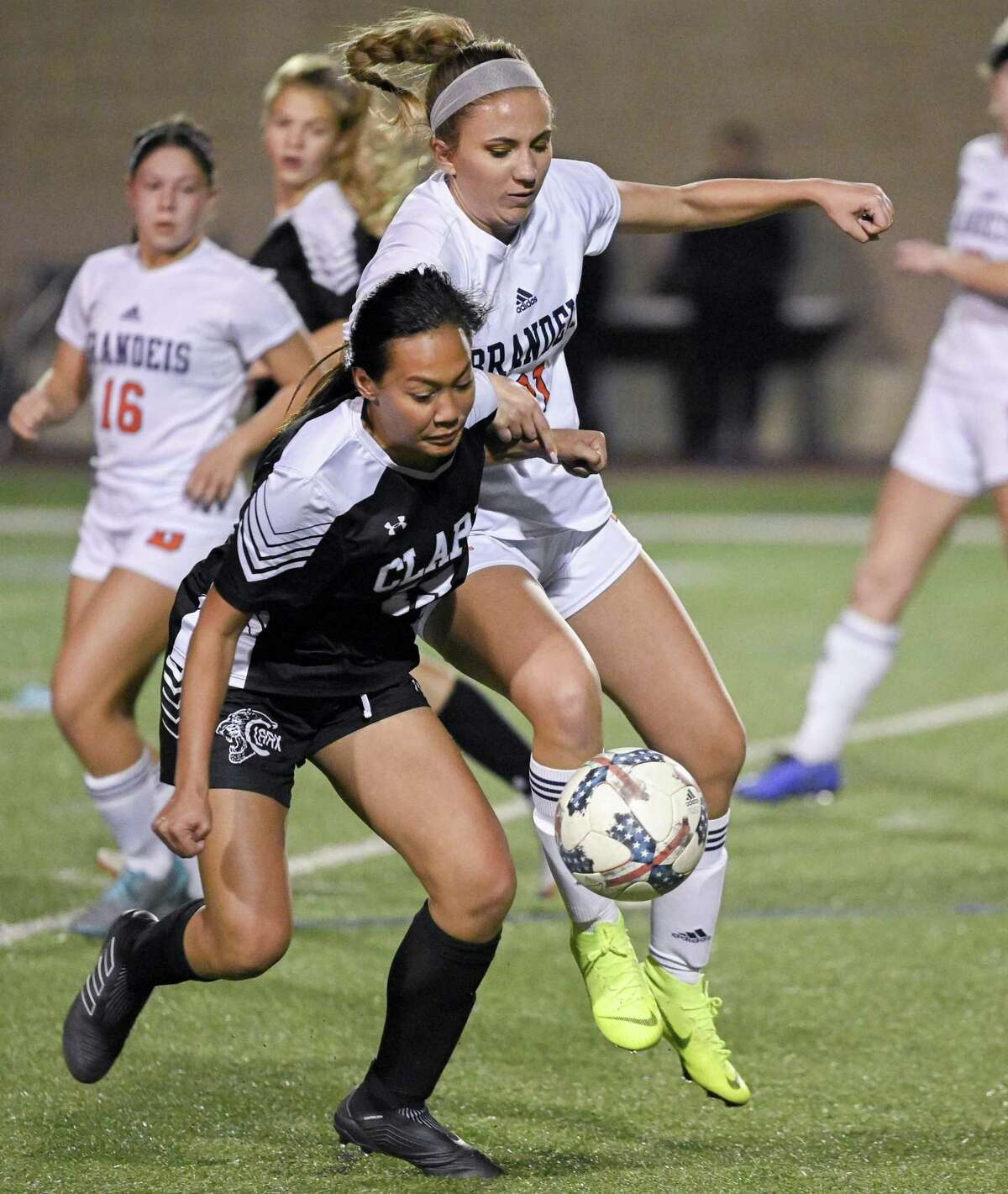 Clark's Hannah Faustino, left, and Brandeis' Kelli Diaz chase the ball during the second half of a girls high school soccer game, Tuesday, Jan. 22, in San Antonio. Clark won 2-1. (Darren Abate/Contributor)