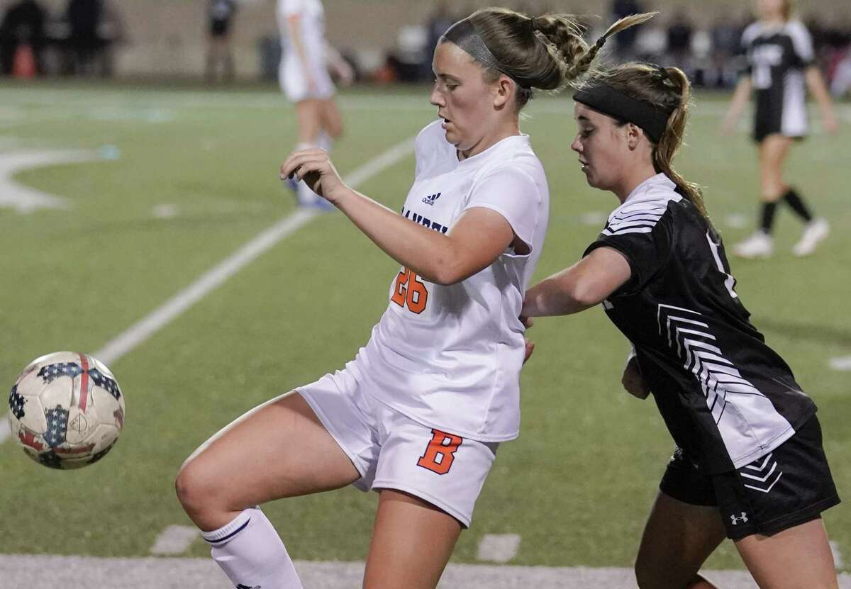 Brandeis' Avery Chaney, left, battles Clark's Lily Allen for control of the ball during the second half of a girls high school soccer game, Tuesday, Jan. 22, in San Antonio. Clark won 2-1. (Darren Abate/Contributor)