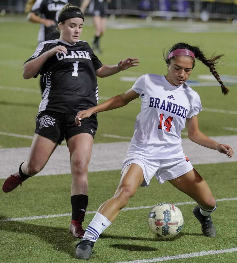 Brandeis' Isabella Benavidez, right, battles Clark's Lily Allen for control of the ball during the second half of a girls high school soccer game, Tuesday, Jan. 22, in San Antonio. Clark won 2-1. (Darren Abate/Contributor) Photo: Darren Abate, FRE / San Antonio Express-News