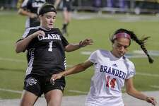 Brandeis' Isabella Benavidez, right, battles Clark's Lily Allen for control of the ball during the second half of a girls high school soccer game, Tuesday, Jan. 22, in San Antonio. Clark won 2-1. (Darren Abate/Contributor)