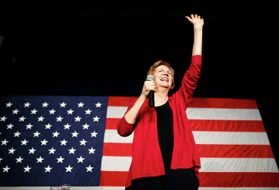 Sen. Elizabeth Warren waves to the crowd during an organizing event in Des Moines, Iowa. Photo: Matthew Putney | AP