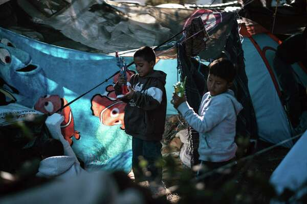 Asylum seeking children play at a makeshift camp near the U.S. and Mexican border crossing in Tijuana, Mexico, on Nov. 26, 2018.