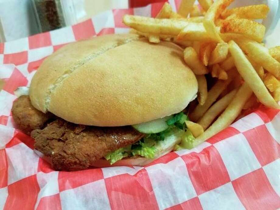 Fried Chicken Sandwich at Sticky Paw Donuts & Diner, located near the Circle at 3124 Jefferson Avenue in Midland