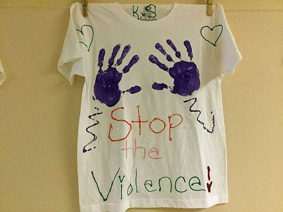 T-shirts with domestic violence awareness messages were hung Tuesday around the Prudence Crandall Center in New Britain. Photo: Jack Kramer / CTNewsJunkie.com
