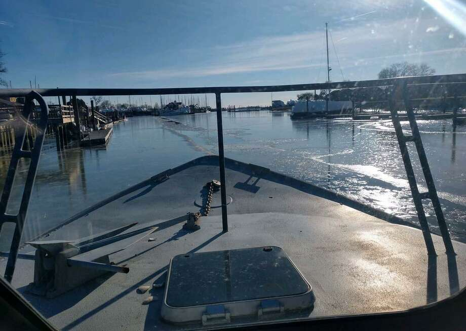 The Norwalk Police Marine Unit dealt with the cold on Tuesday, Jan. 22, 2019 while breaking through the ice in Charles Cove. Photo: Norwalk Police Department Photo