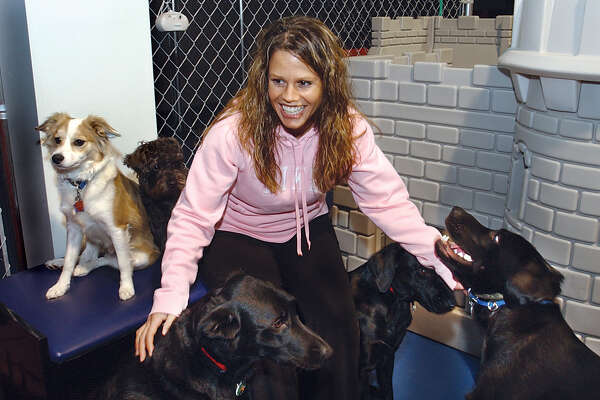 Doggie Castle Daycare owner Maria Gazzara's busiiness has been open for six months in Cromwell..........TW photo..........111804