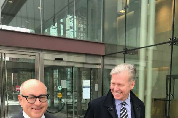 """""""To Catch a Predator"""" star and longtime Shippan resident Chris Hansen, right, appeared in court early Wednesday with his attorney Phillip Russell, left, on charges levied earlier this month that he bounced checks to a local business."""