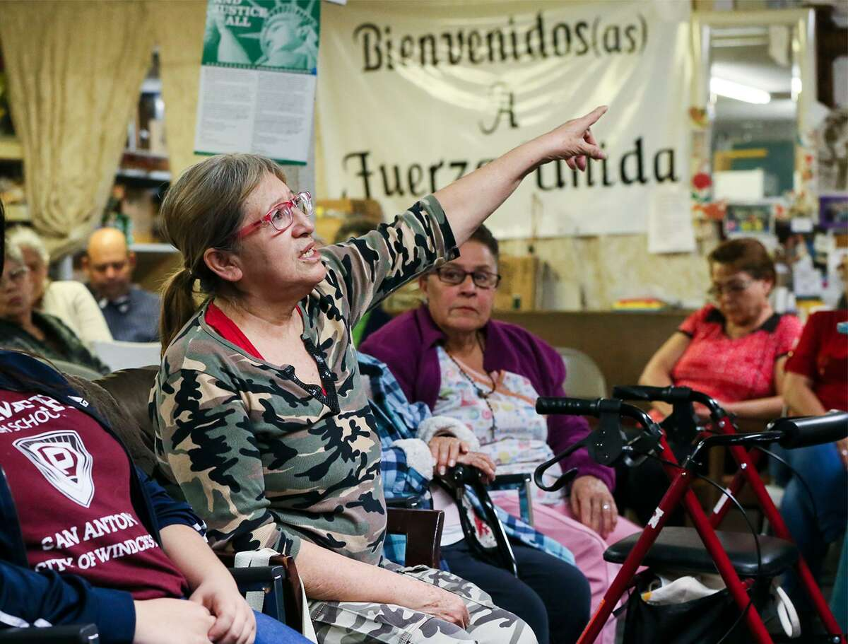 Araceli Herrera (center) speaks at a celebration of Fuerza Unida at its headquarters on New Laredo Highway on Tuesday, Jan. 22. It's an organization started by a group of South Side women who were laid off when the Levi's plant closed in 1990. This is the group's 29th year of fighting for environmental, economic and social justice.