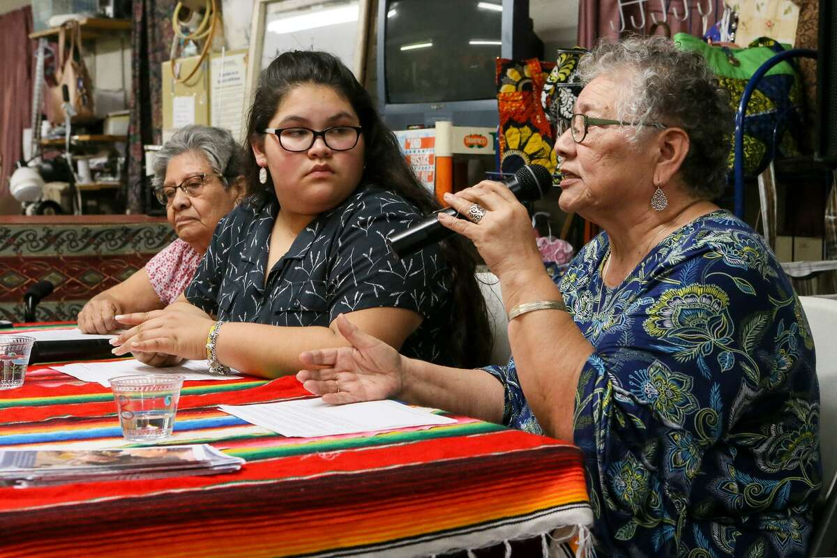 Petra Mata (from right) speaks from the head table along with Olivia Quintero, 14, and Viola Casares at the Fuerza Unida headquarters on New Laredo Highway on Tuesday, Jan. 22. Mata and Quintero are co-founders and co-directors of Fuerza Unida, an organization headed by South Side women, celebrating its 29th year of fighting for environmental, economic and social justice. Quintero is a participant in the organization's youth program.