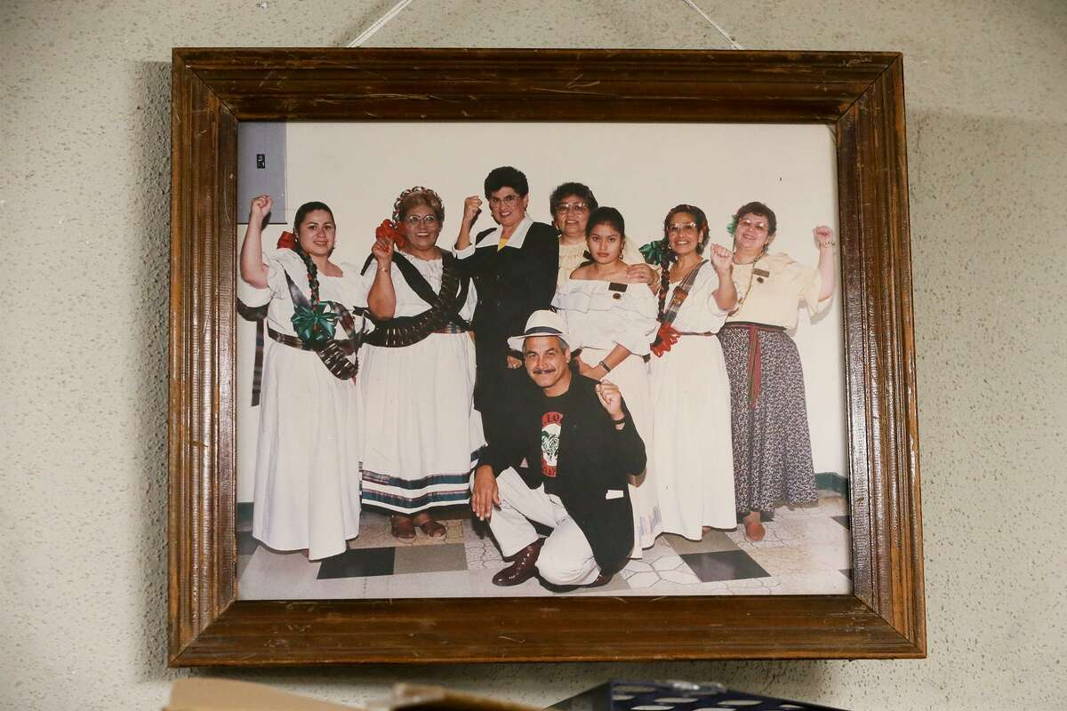 A mid-1990s photo shows former City Councilwoman Maria Antonietta Berriozabal (center, in black) with Fuerza Unida co-founders Petra Mata (fourth from right) and Viola Casares (second from right). Mata and Casares started Fuerza Unida after the Levi's plant on Zarzamora where they were worked was shut down and more than 1,000 women were laid off. The organization had a celebration at its headquarters on New Laredo Highway on Tuesday, Jan. 22, 2019, marking its 29th year of fighting for environmental, economic and social justice.
