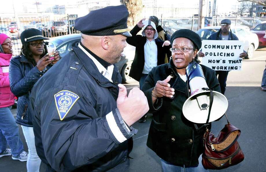 Barbara Fair, right, speaks to a New Haven police officer during a protest in front of the New Haven Police Department in 2015. Photo: Hearst Connecticut Media File
