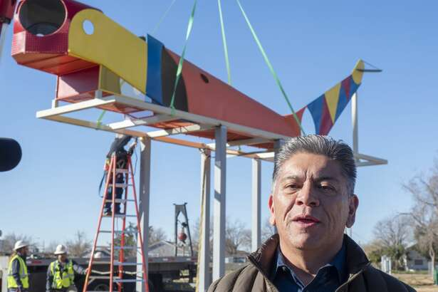 Mayor Jerry Morales speaks 01/23/19 as crews work to place the refurbished airplane playground equipment at Dennis the Menace Park. The old structure is being placed as a monument to the history of the park and will not be accessible to children to play on. Tim Fischer/Reporter-Telegram