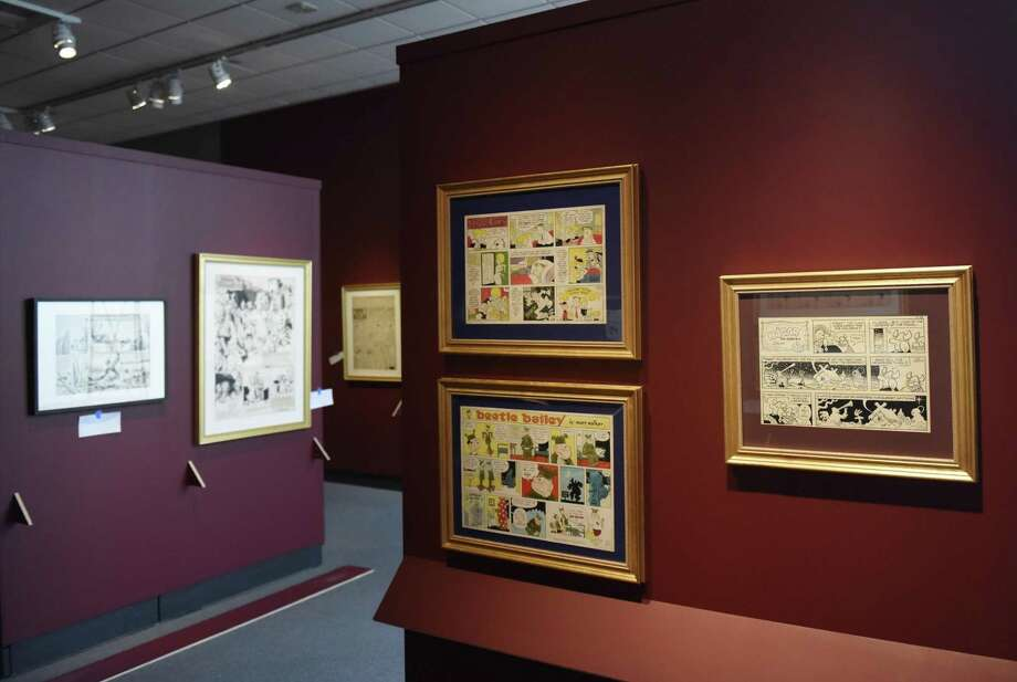 """Hi and Lois,"" ""Beetle Bailey,"" and ""Hagar the Horrible"" original cartoon strips are displayed at the ""Masterpieces from the Museum of Cartoon Art"" show at the Bruce Museum in Greenwich, Conn. Tuesday, Jan. 15, 2019. More than 100 original works ranging from the 1880s to present day are displayed, including classic ""Peanuts,"" ""Doonesbury"" and ""Calvin & Hobbes"" pieces. The exhibition opens Jan. 26 and runs through April 20. Photo: Tyler Sizemore / Hearst Connecticut Media / Greenwich Time"