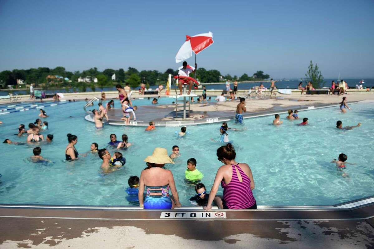 Hundreds of folks swim in the pool at Byram Park in the Byram section of Greenwich, Conn. Monday, July 2, 2018.