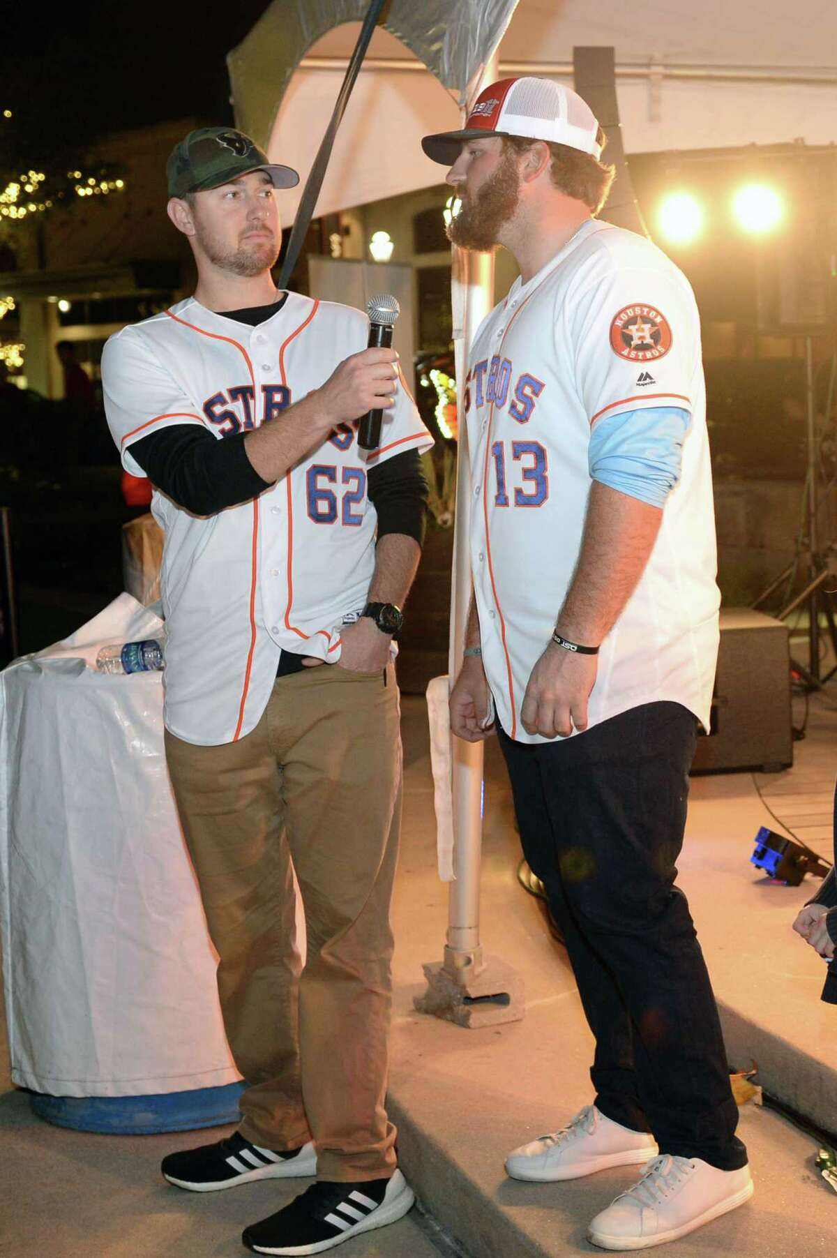 Astros players Brady Rodgers (left) and Tyler White (right) talk to fans as the Astros Caravan makes a stop at LaCenterra in Katy, on Tuesday, January 22, 2019.
