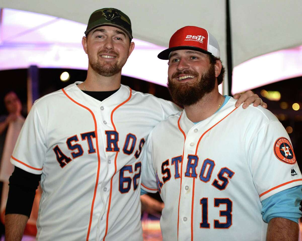 Astros players Brady Rodgers (62) and Tyler White (13) pose together as the Astros Caravan makes a stop at LaCenterra in Katy, on Tuesday, January 22, 2019.