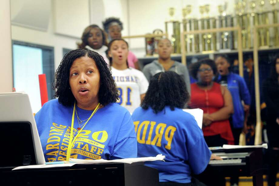 With members of one of her classes reflected in a mirror behind her, Sheena Graham leads choir practice at Harding High School, in Bridgeport, Conn. Sept. 21, 2018. Graham has been selected as a finalist for the 2019 Connecticut Teacher of the Year. Photo: Ned Gerard / Hearst Connecticut Media / Connecticut Post