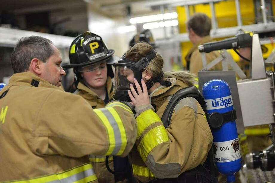 """Members of the Haddam Volunteer Fire Department participated in a drill known as """"Jeff's Box"""" Jan 14. Photo: Olivia Drake Photo"""