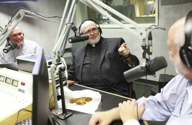 "Father Mario Arroyo makes a point with Rabbi Stuart Federow, as Dr. David Capes smiles during the taping of ""A Show of Faith"", a local call-in radio station that discuss religion and news of the day on Sunday, Dec. 23, 2018 in Houston."