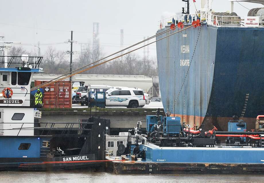 Emergency personnel are working on removing a body from the water in Port Arthur January 23, 2019.
